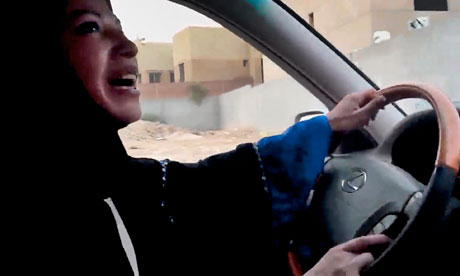 A Saudi Arabian woman drives a car as part of a campaign to defy the ban on women driving