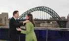 Lib Dem leader Nick Clegg greets MP Jo Swinson in front of the Tyne bridge