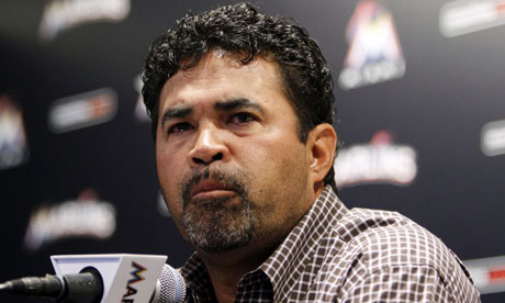 Ozzie Guillen apologises at a press conference