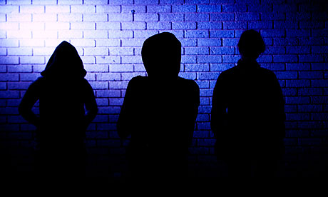 Silhouettes of three teenagers UK