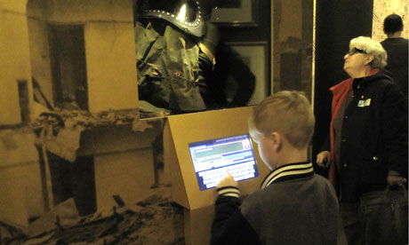 child using IWM kiosk
