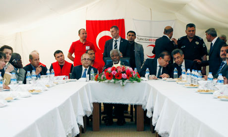 Kofi Annan, centre, at a meeting with representatives of Syrian refugees at Yayladagi refugee camp, Turkey. Photograph: Umit Bektas/AP