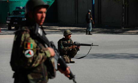 Afghan National Army soldiers hold positions near the scene of an attack in Kabul