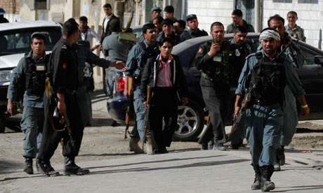 Afghan security forces arrive at the site of a battle in Kabul