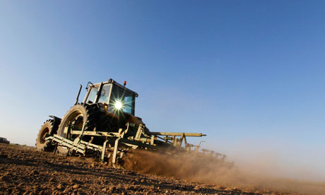 Dust rises from a field as a tractor works the dry earth in Blecourt