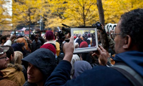 A man uses an ipad to document Occupy protests