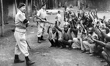 British troops round up Kenyan locals for interrogation during Mau May uprising