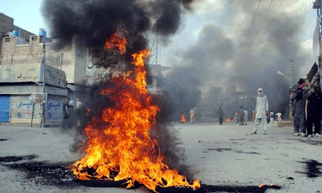 Pakistani protesters burn tyres in protest at the killing of shopkeeper Salman Ali in Quetta