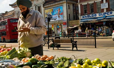 Man stands by a market stall in London
