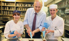 Employment minister Chris Grayling with apprentice chefs at the Doubletree Hilton Hotel