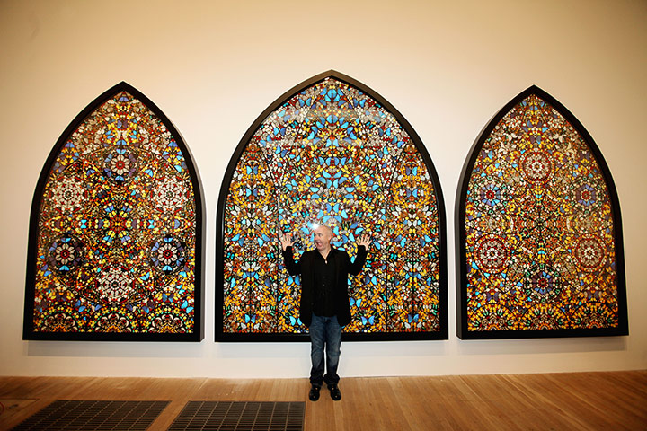 Damien Hirst: Damien Hirst poses infront of 'Doorways to the Kingdom of Heaven'