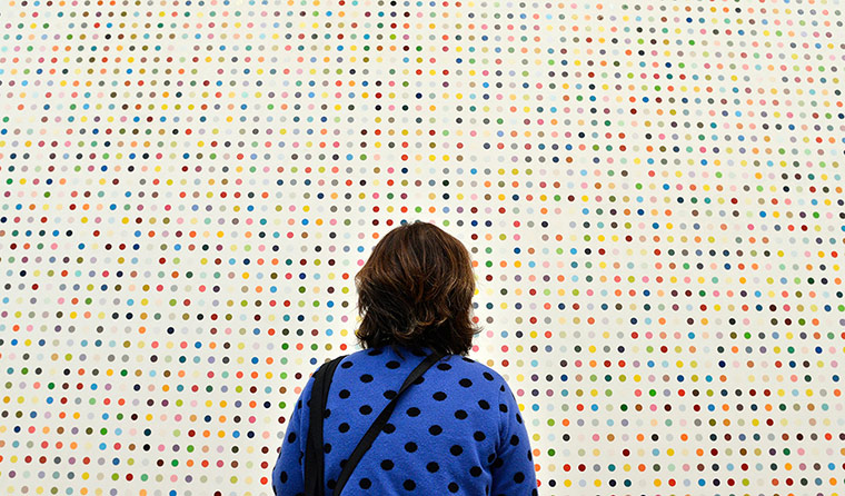 Damien Hirst: A visitor views one of the Spot paintings by Damien Hirst