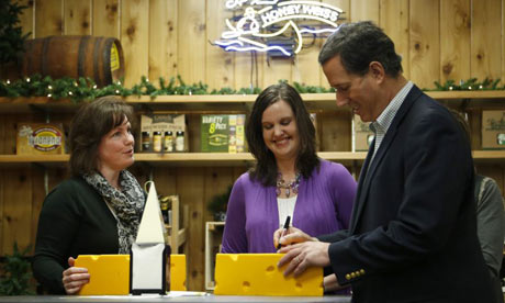 Rick Santorum signs block of cheese