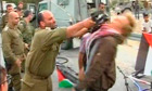 Israeli soldier Shalom Eisner strikes Danish protester Andreas Ias with his rifle