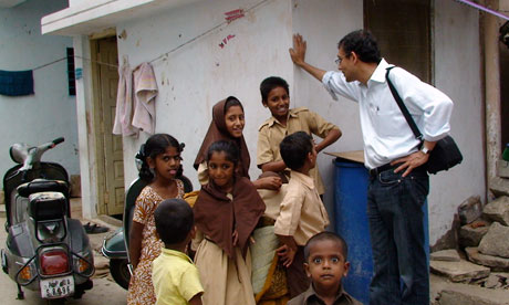Banerjee in India on work projects for Poverty Action Lab.