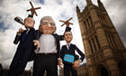 'Rupert Murdoch' holds up puppets of David Cameron and Jeremy Hunt