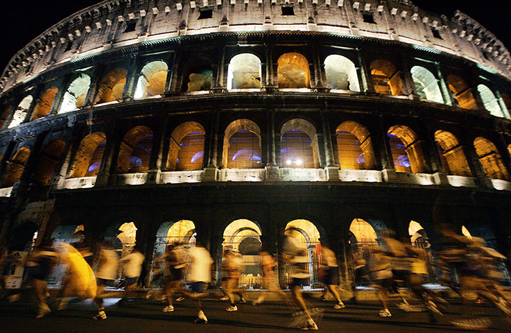 50 moments: Competitors run past the ancient Roman Colosseum