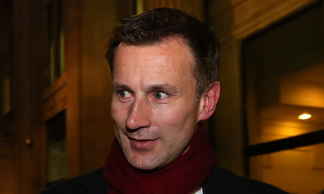 Culture Secretary Jeremy Hunt leaves his office
