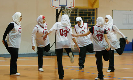 Saudi Arabia's Jeddah United warm up before a basketball game in Amman. The kingdom has never fielded a woman athlete at the Olympics.