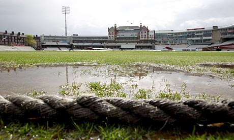 Heavy rain floods the outfield at the Kia Oval in London