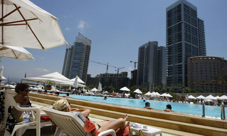 Tourists cool off in a pool in Beirut