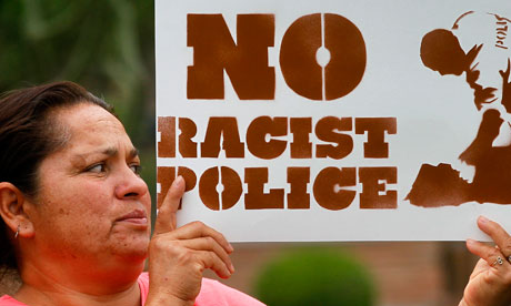 no racist police protest sign