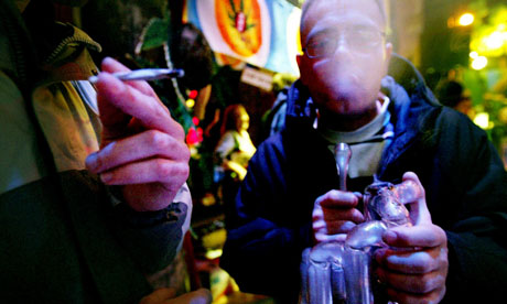 People smoke cannabis at a cannabis cafe in the Netherlands