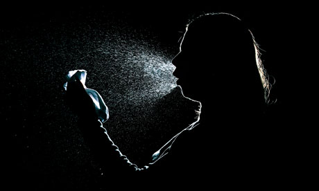 Silhouette of a woman coughing or sneezing