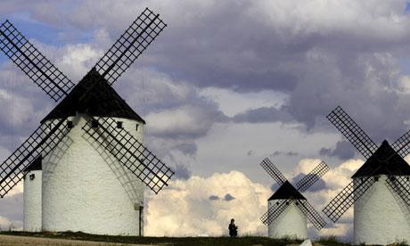 Tourists visit the famous ancient windmillsCastilla-La Mancha