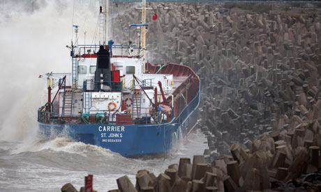 The grounded cargo ship Carrier is battered by waves as it lays against sea defences in Llanddulas