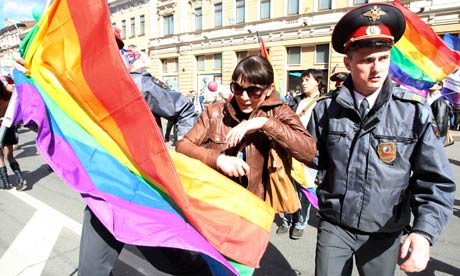 Police detain a gay rights activist in St Petersburg. Photograph: Reuters