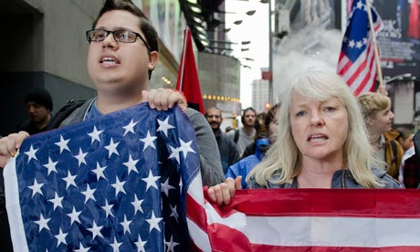 Mario Lozada and Eileen Maxwell take part in an Occupy march in New York on May Day.