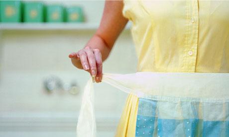 Woman putting on apron