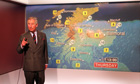 Prince Charles reads the weather forecast during a tour of BBC Scotland Headquarters in Glasgow