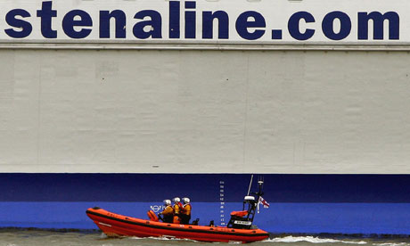 A lifeboat passes a Stena Line ferry in Belfast Lough during a search for a reportedly missing baby