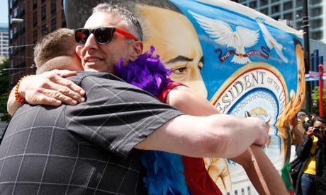 Men hug in a show of support as Barack Obama visits Seattle on Thursday