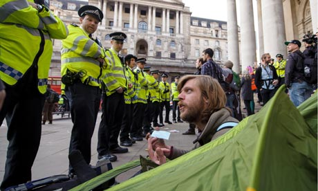 Police and an Occupy demonstrator near the Bank of England in London
