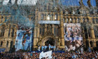 Manchester City players parade the Premier League trophy in front of thousands of fans