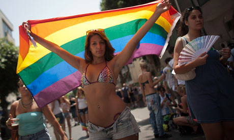 Woman flying the Gay Pride flag