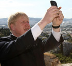 Boris Johnson takes a photo at the Acropolis in Athens on 17 May 2012.