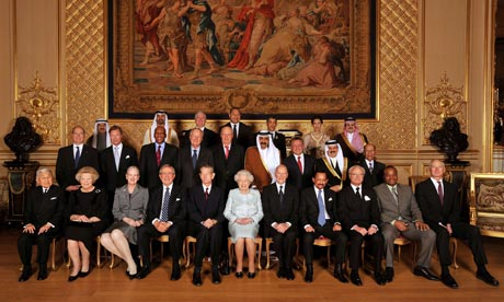 The Queen poses for a formal picture with her guests before a sovereign monarchs jubilee lunch