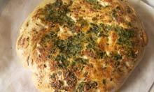 Nigella garlic and parsley haerthbread