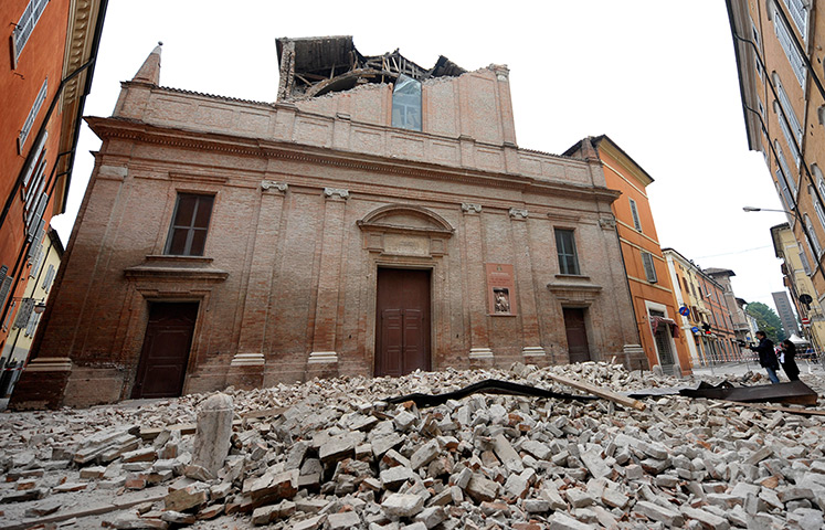 earthquake in italy: Debris of a collapsed church blocks a road in Finale Emilia
