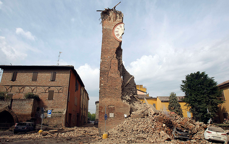 earthquake in italy: The debris from a collapsed clock tower