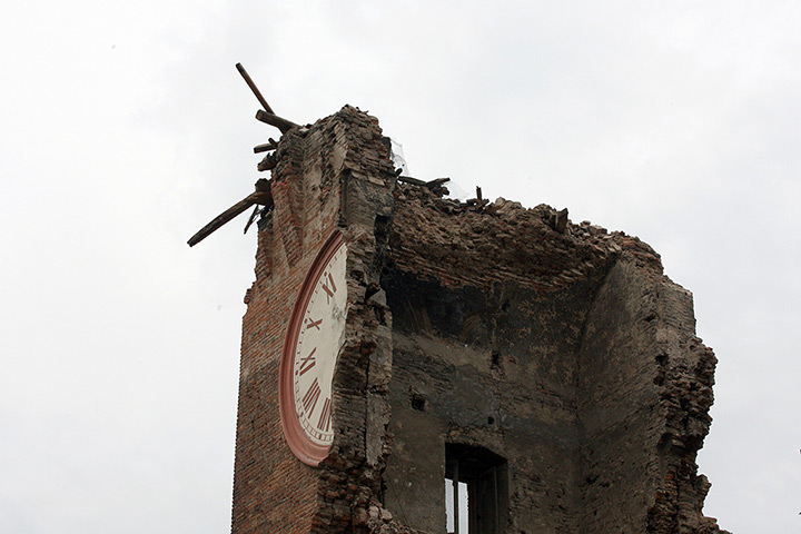 earthquake in italy: the  tower which collapsed following an earthquake in Finale Emila