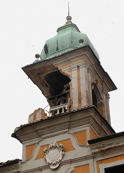 earthquake in italy: The damaged bell tower of  Finale Emilia city hall building