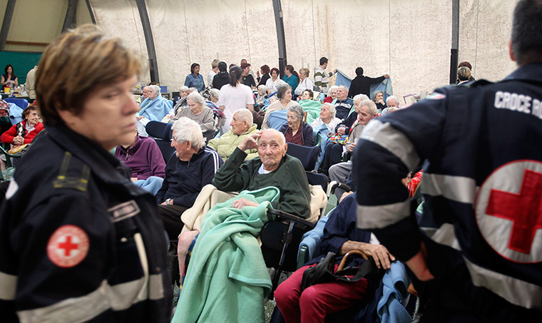 earthquake in italy: Elderly people receive first aid after an earthquake in Finale Emilia