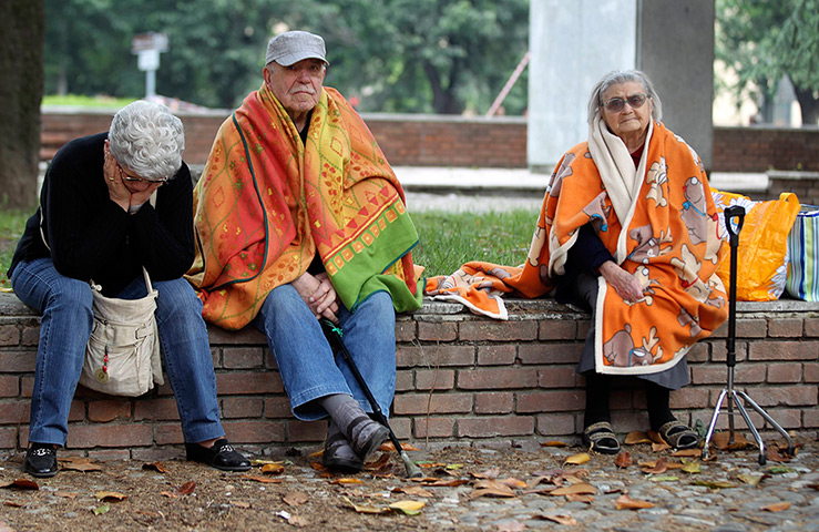 earthquake in italy: Elderly residents sit outdooors after the earthquake