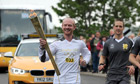 Torchbearer 033 Adam Smith carries the Olympic flame