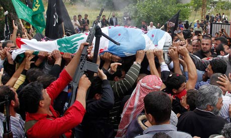 Lebanese Sunni Mulsims mourners and gunmen carry the body of Sheikh Ahmed Abdul Wahid